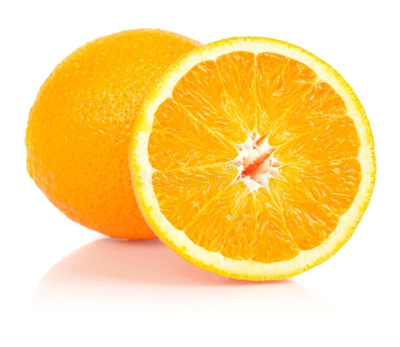 Whole and halved orange. Whole and halved ripe orange isolated on white background royalty free stock photo