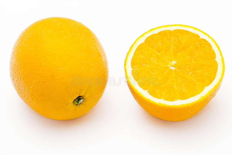 Whole and halved oranges. Isolated on white background stock photos
