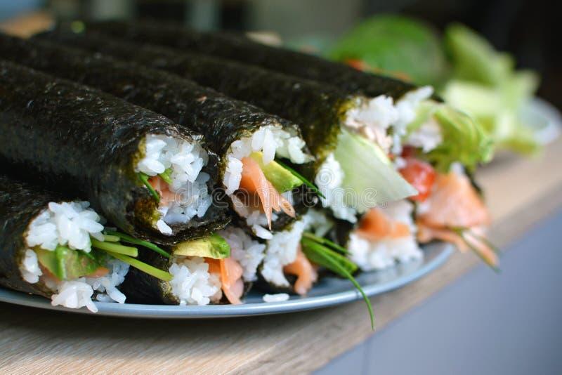 Whole homemade sushi rolls stock photography
