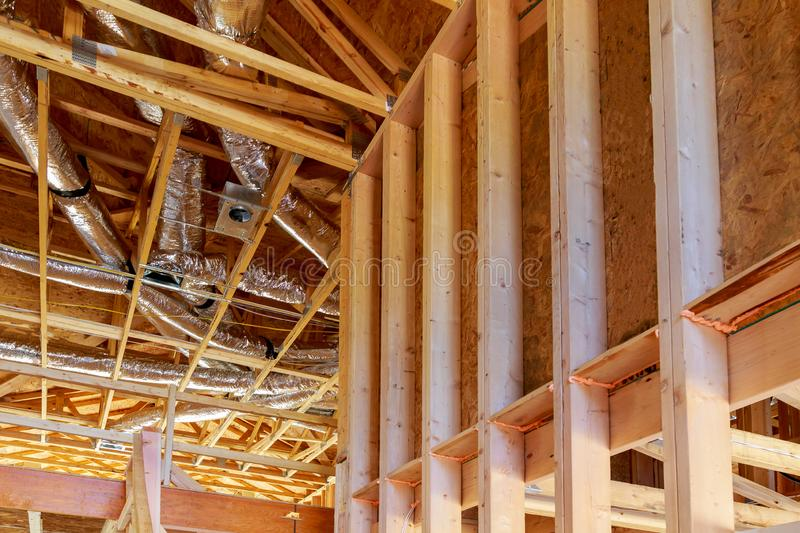 Whole house air ventilation and cleaning system in silver insulation material on the attic. Construction home framing industry building new industrial stock images