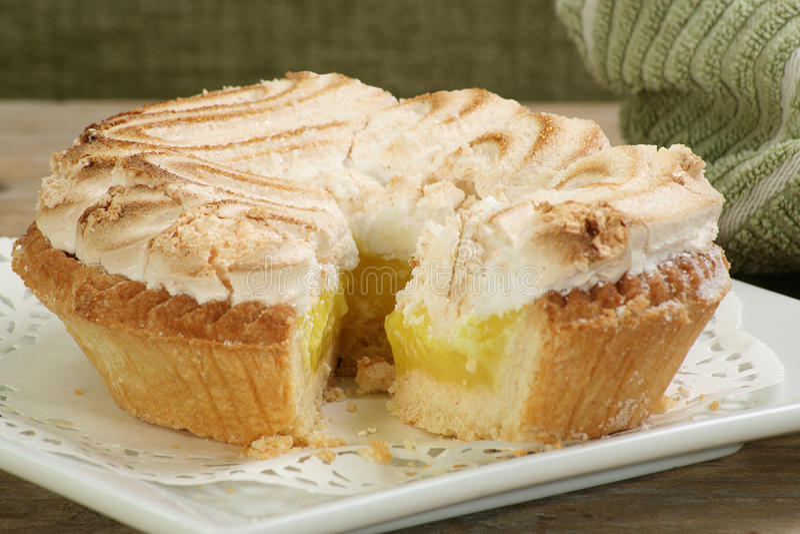 Whole lemon meringue pie stock photography