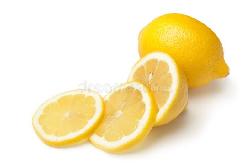 Whole Lemon and Slices on White Background