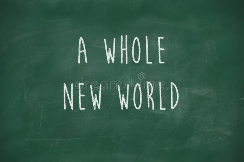 A whole new world handwritten on blackboard. A whole new world handwritten on school blackboard royalty free stock photos