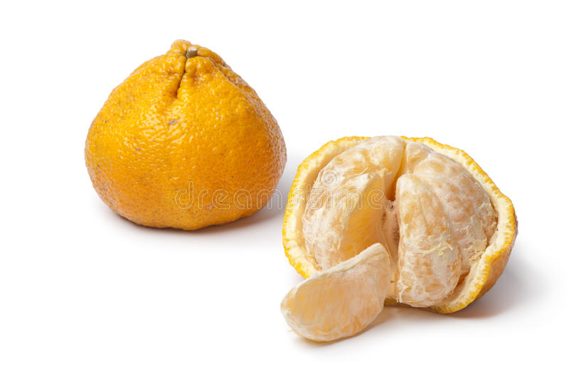 Whole and partial peeled ugli fruit royalty free stock image