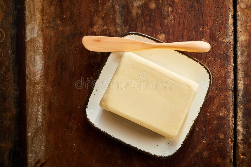 Whole pat of farm fresh creamy butter stock images