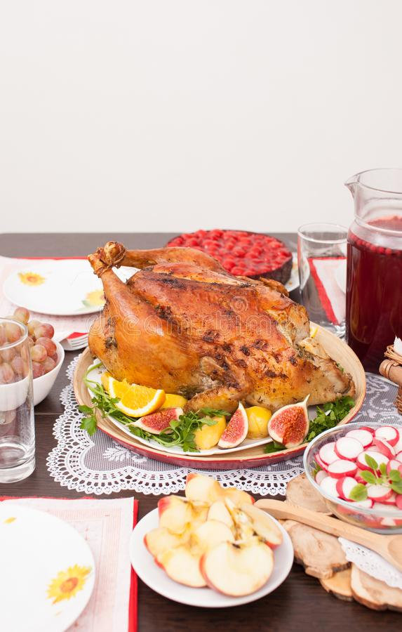 Whole roast Turkey with fruit on the festive table stock images