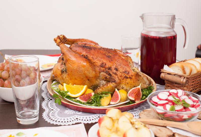 Whole roast Turkey on a platter with oranges and figs royalty free stock photos