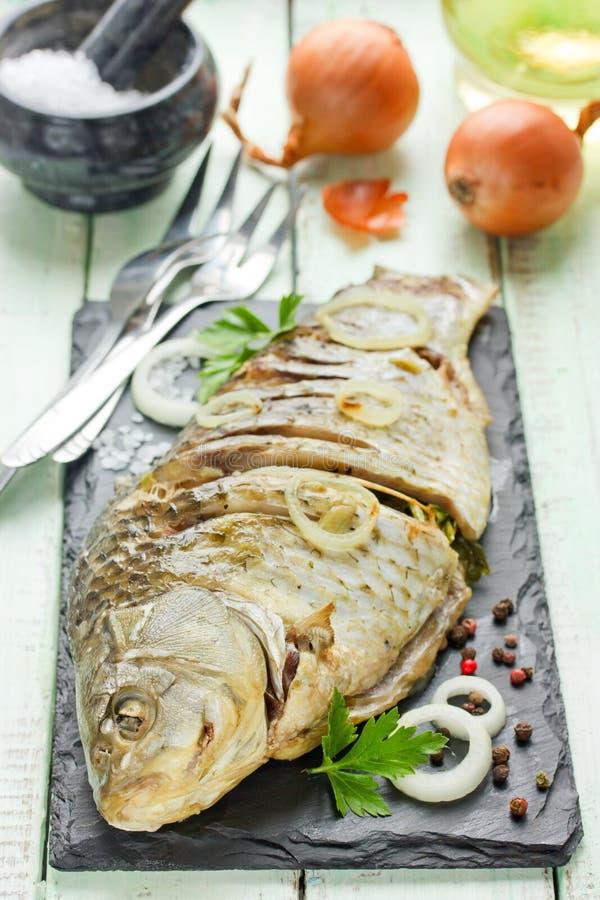 Whole roasted carp royalty free stock photo