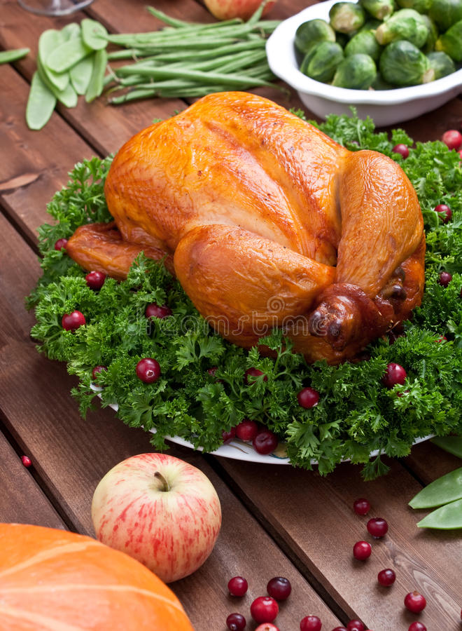 Whole roasted chicken with parsley royalty free stock photo