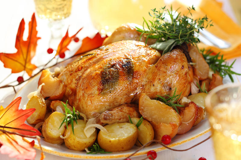 Whole roasted chicken with potatoes and apples stock image
