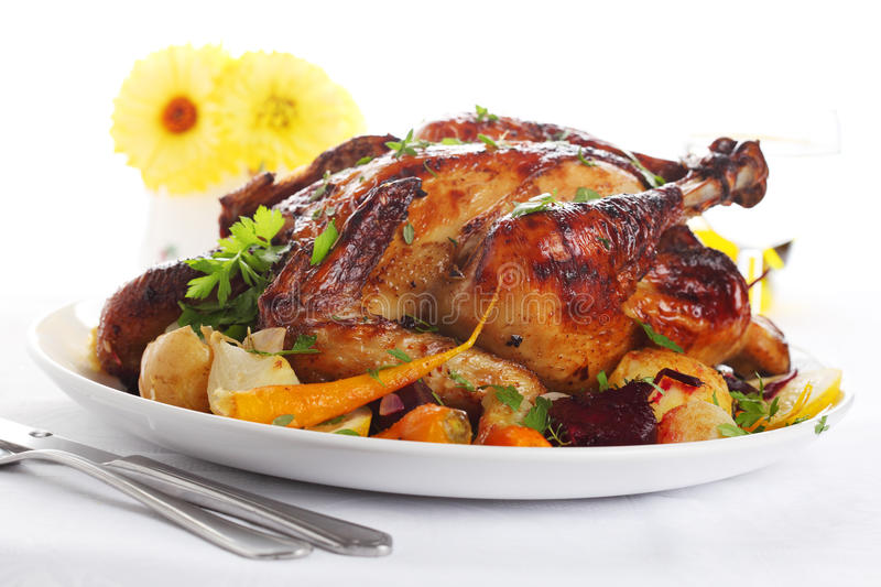 Whole roasted chicken with vegetables royalty free stock photo
