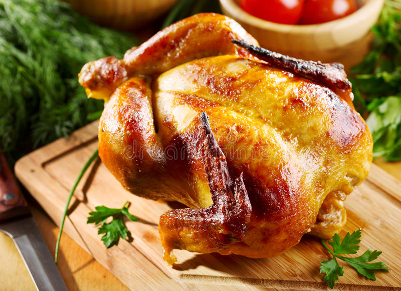 Whole roasted chicken. With vegetables stock photos