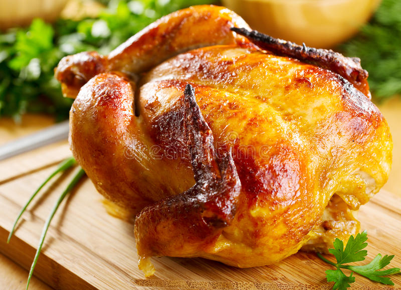 Whole roasted chicken. With vegetables stock photography