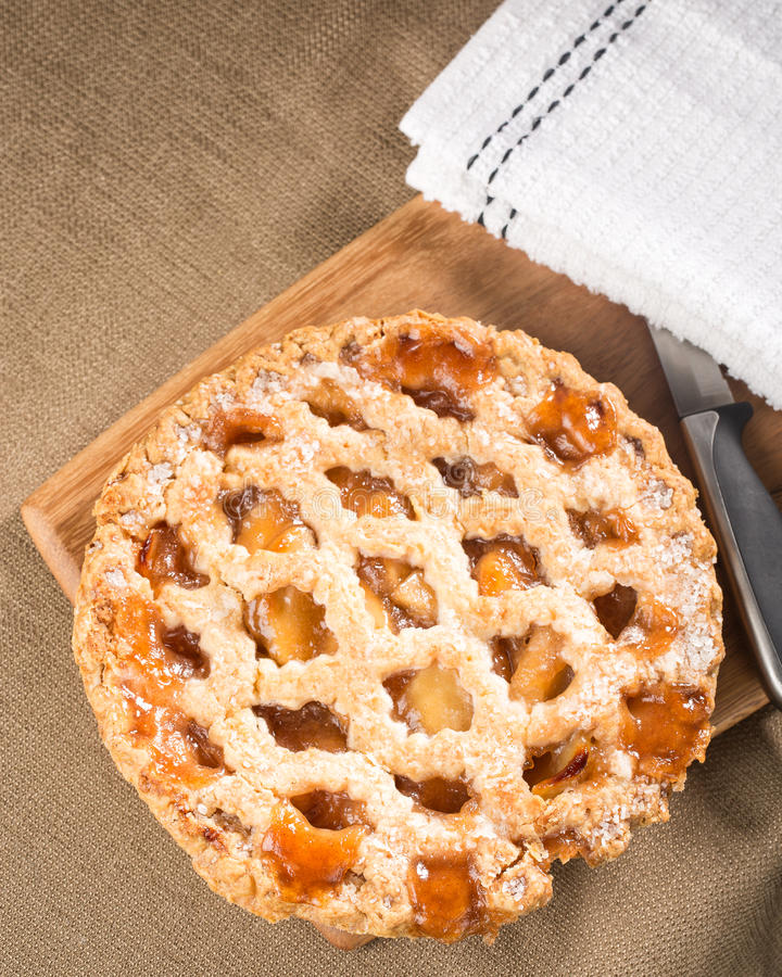 Whole rustic apple pie shown from above stock photo