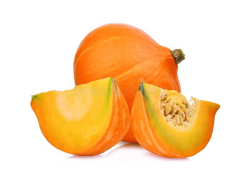Whole and slice japanese pumpkin isolated on white royalty free stock images