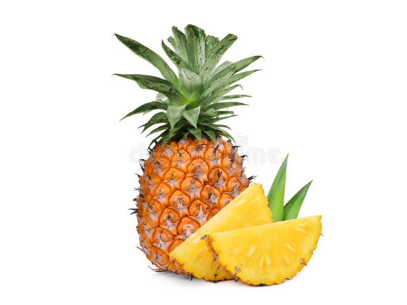 Whole with slice ripe pineapple isolated on white. Background royalty free stock photo