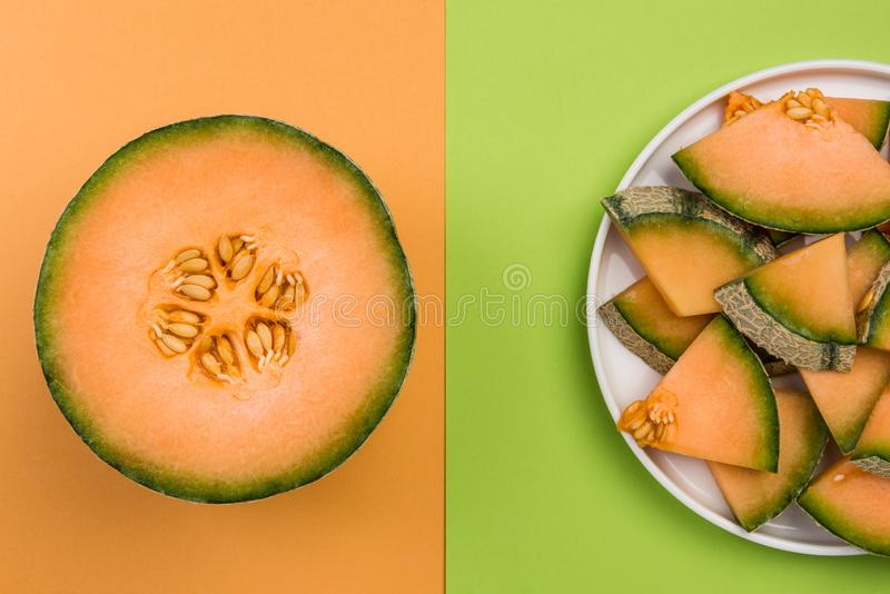 Whole and SLiced Cantaloupe Melon on Pastel Background with Copy Space royalty free stock images