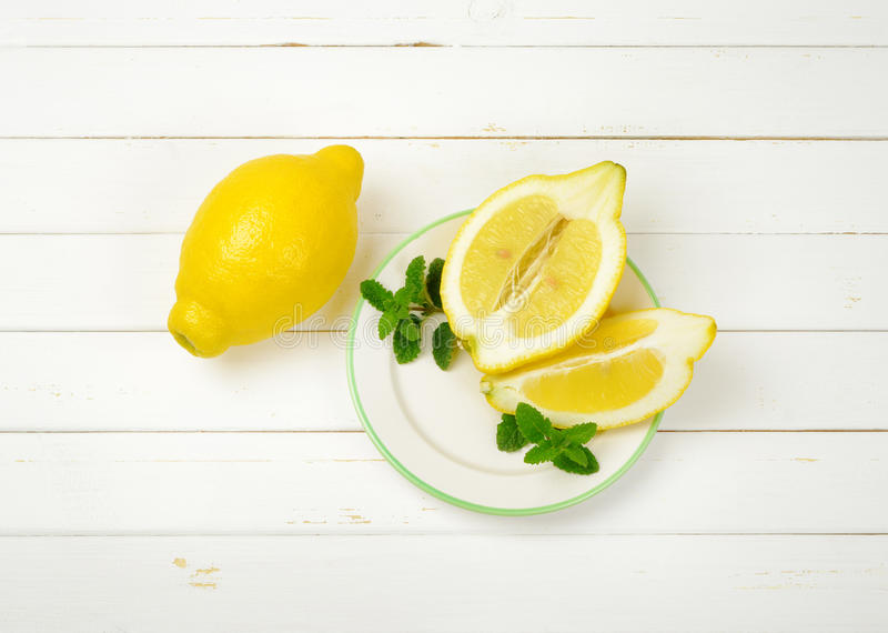Whole and sliced lemons stock image