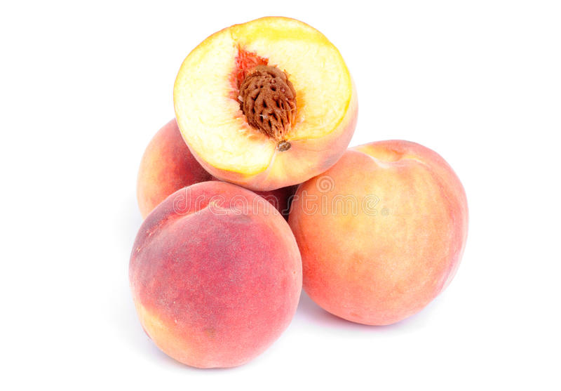 Whole and sliced peach royalty free stock photography