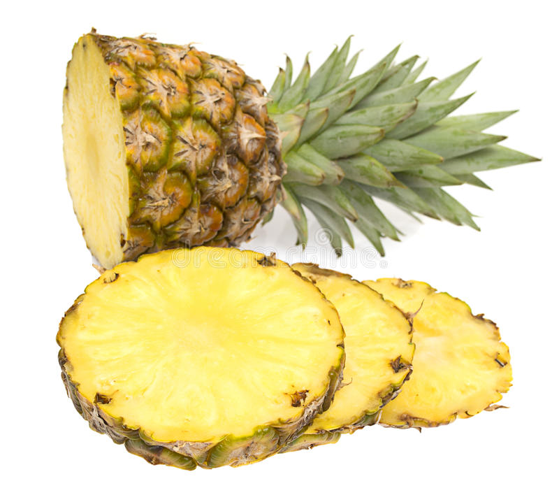 Whole and sliced pineapple stock photo