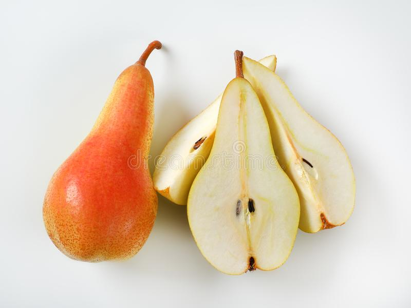 Whole and sliced yellow pears royalty free stock photos