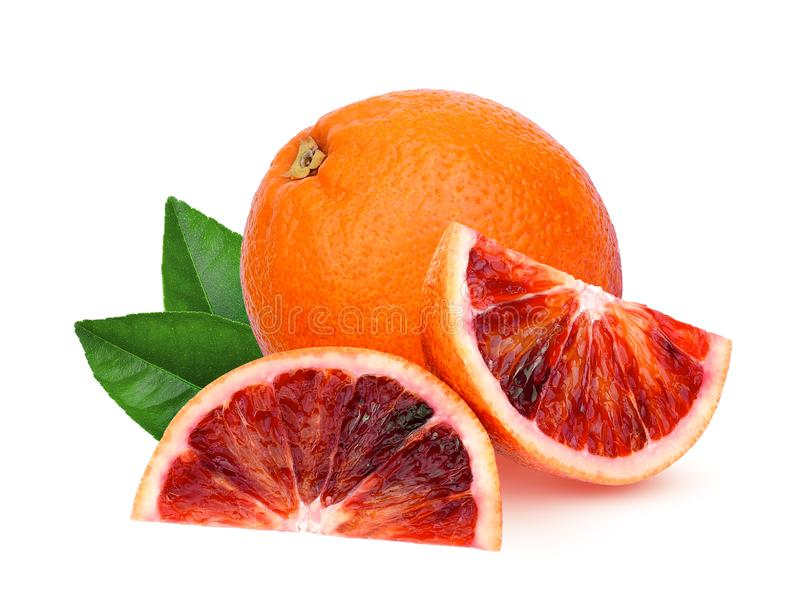 Whole and slices blood orange with green leaf isolated on white royalty free stock image