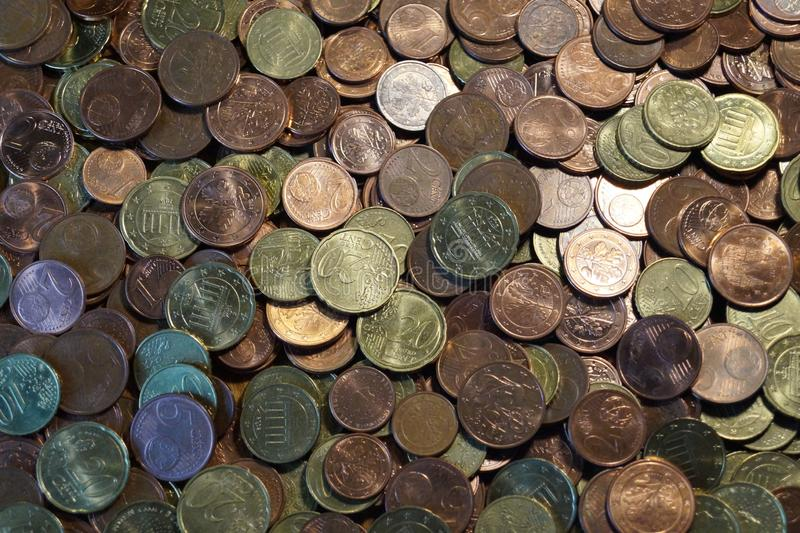 A packet of euro cent coins. A whole stack and packet of different euro cent coins royalty free stock photo