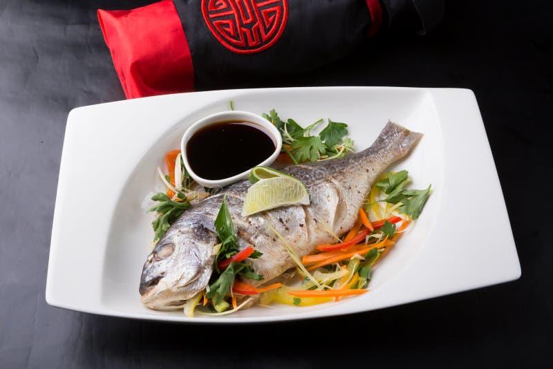 Whole steamed dorado fish royalty free stock photo