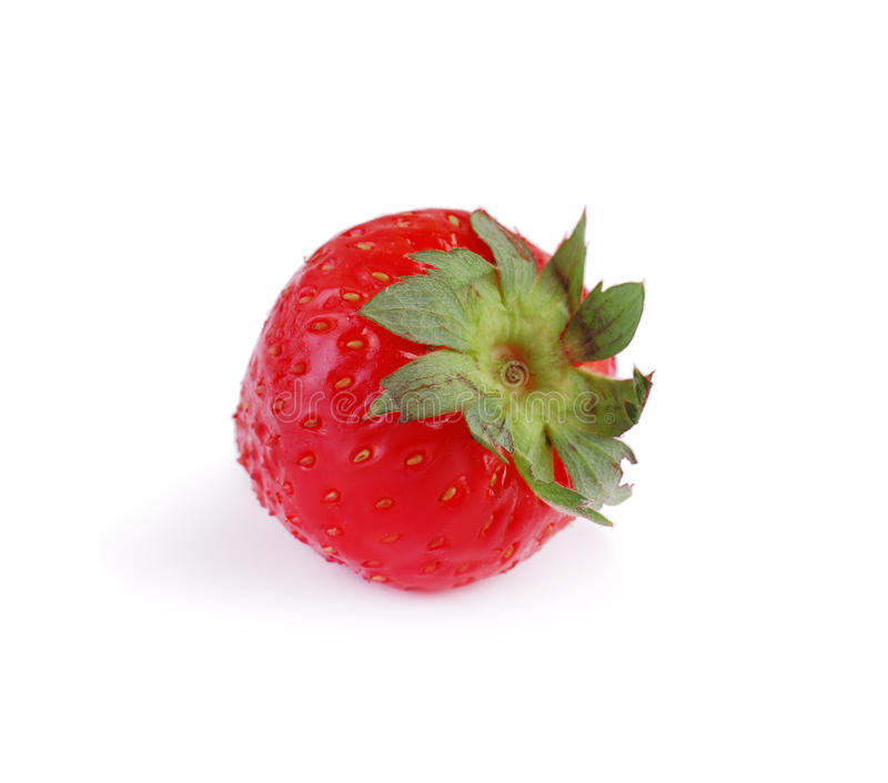 A whole strawberry isolated on a white background. A tasty red strawberry with bright green leaves. Healthful fruits concept. A vivid red and delicious royalty free stock photography