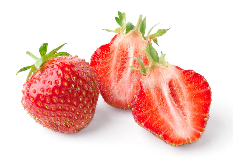 Whole strawberry and strawberry cut in half stock photos