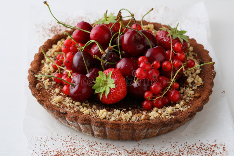 Whole Summer berry tart. Food closeup royalty free stock image