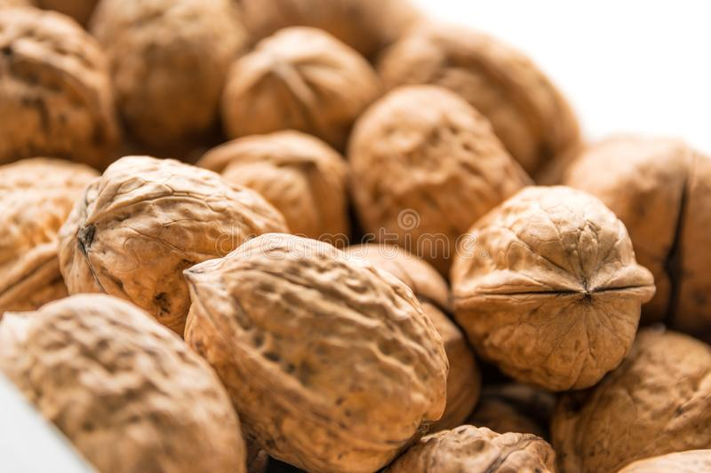 Whole walnuts background. Bunch of walnuts stock photography