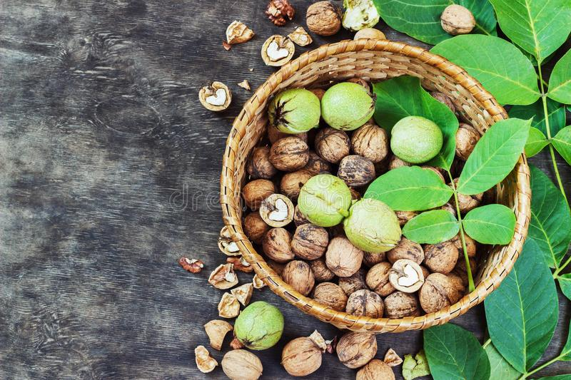 Whole Walnuts and Cleared in the basket Black Wooden Background Top view Healthy concept stock photography