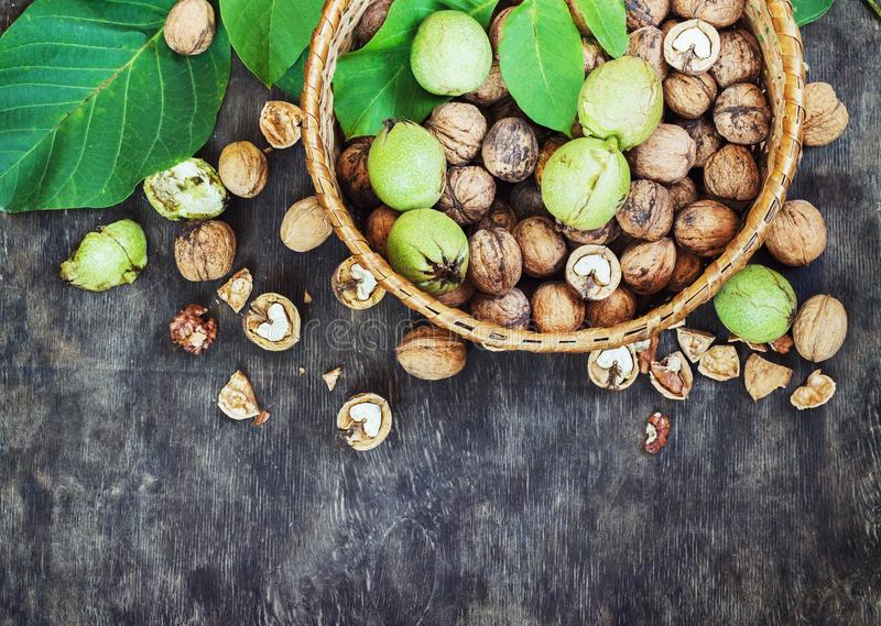 Whole Walnuts and Cleared in the basket Black Wooden Background Top view Healthy concept royalty free stock photography