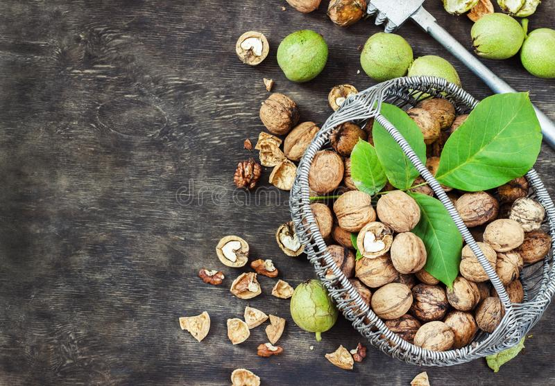 Whole Walnuts and Cleared in the basket Black Wooden Background Top view Healthy concept royalty free stock image