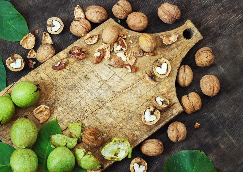 Whole Walnuts and Cleared Black Wooden Background Top view Healthy concept royalty free stock photo