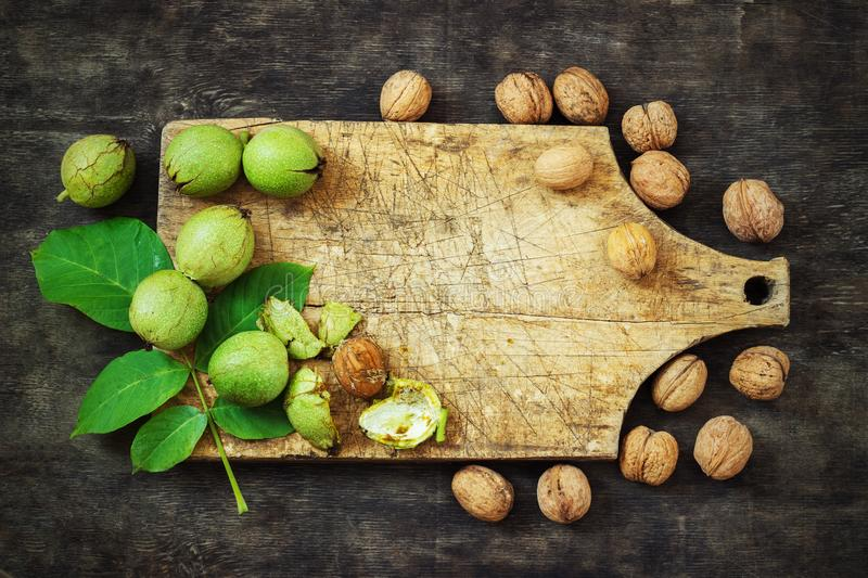 Whole Walnuts and Cleared Black Wooden Background Top view Healthy concept royalty free stock images
