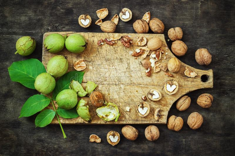 Whole Walnuts and Cleared Black Wooden Background Top view Healthy concept stock images