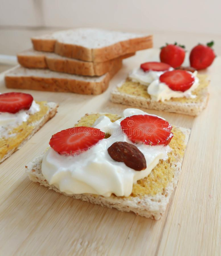 Whole wheat bread and canape with strawberry royalty free stock photo