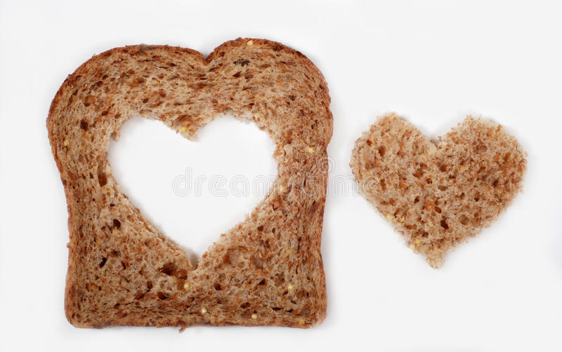 Whole wheat bread with heart stock photo