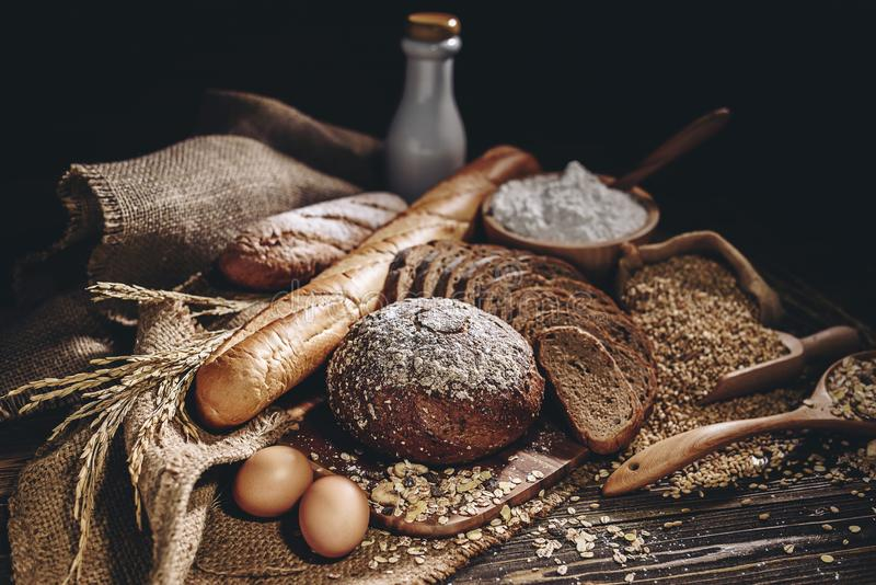 Whole wheat bread and home cooking ingredients that are healthy and nutritious royalty free stock images