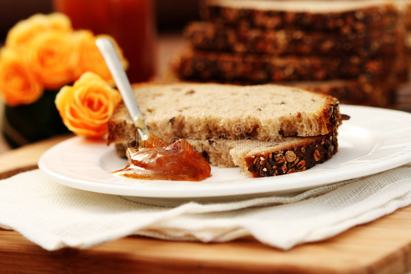 Whole wheat bread and jam stock photo
