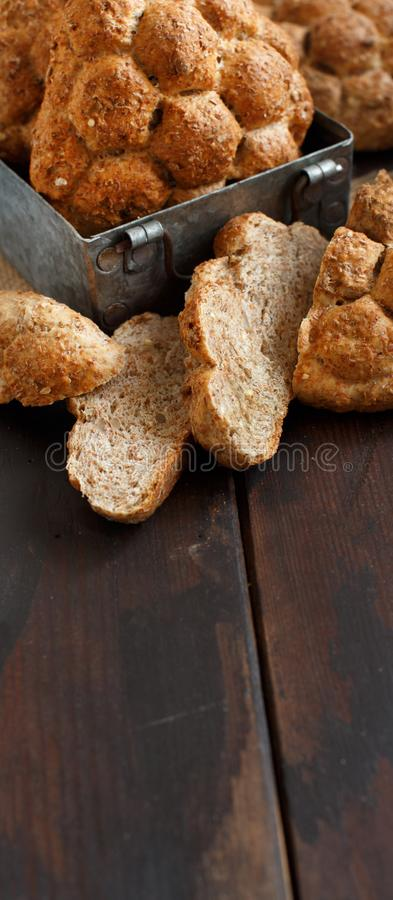 Whole wheat bread on a Wooden Table stock images
