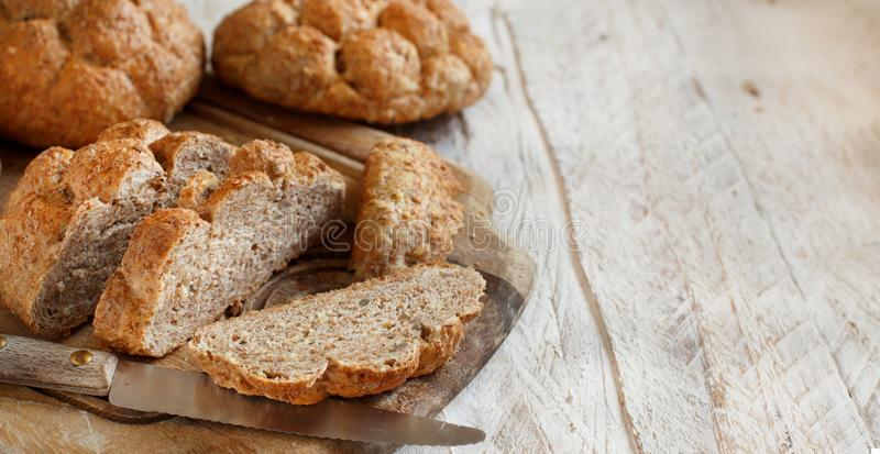 Whole wheat bread on a Wooden Table royalty free stock images