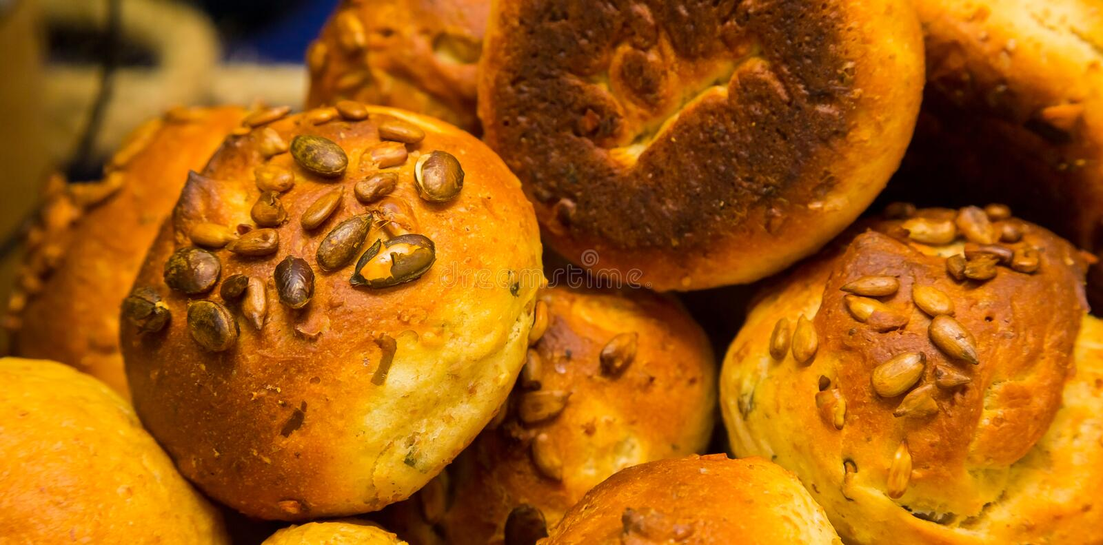 Whole Wheat brown bread rolls at Spring Festival. Picnic event royalty free stock photography