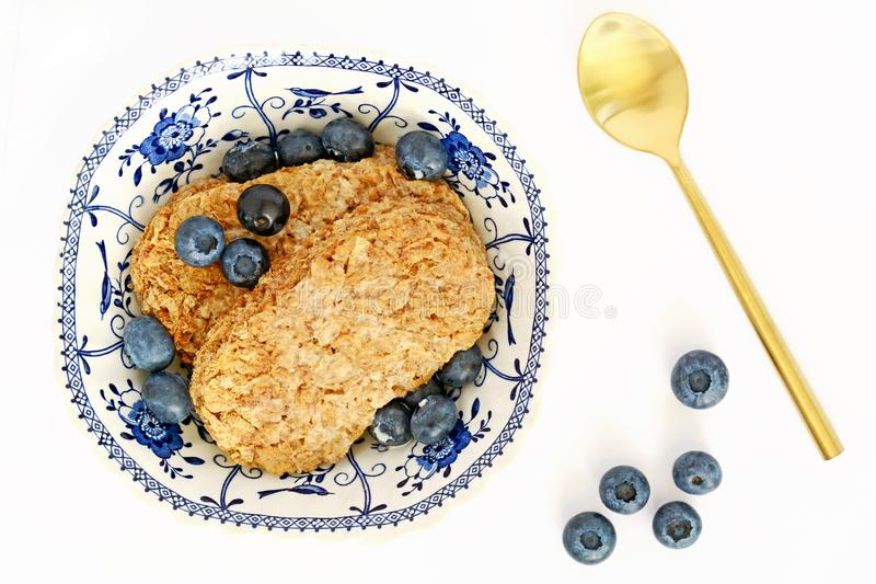 Whole wheat cereal biscuit with blueberries stock image