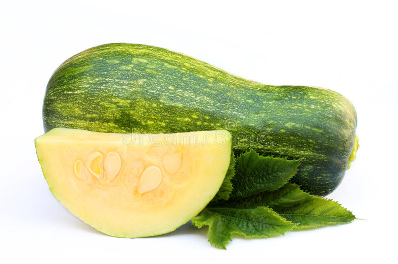 Whole zucchini and a slice isolated. On white stock image