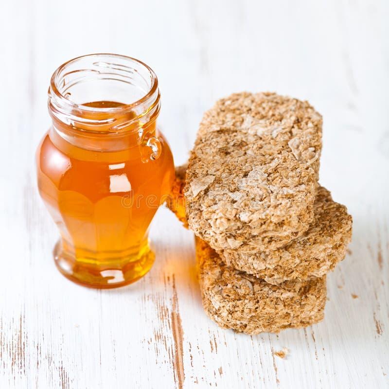Download Wholegrain bisks and honey stock image. Image of meal - 22841379