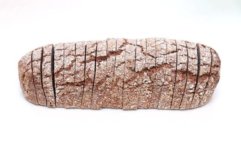 Wholegrain broodbrood op wit stock fotografie