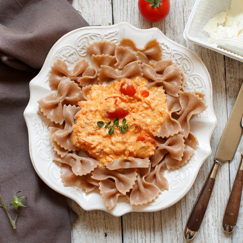 Wholegrain Pasta with stracchino cheese and fresh tomatoes stock images